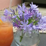 A vase of fresh flowers at Breezes compliments a refreshing Rum Swizzle.