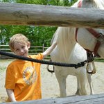 "Son with his horse for ""pony"" ride"