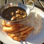 Chicken Curry with rice and chips.