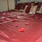 Bed with rose petals