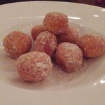 Zeppole - Italian pastry consisting of a deep-fried dough ball dusted in sugar and served with c