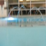 colored lights on fountain in pool