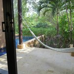 A view out from the bedroom of a Sanctuary Pool Villa