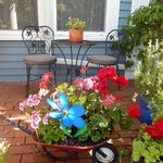 Flowers and bistro set on front porch