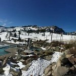 The pool at el. 8200' surrounded by snow capped mountains