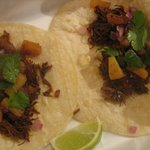 Slow cooked pork carnitas tacos with gril