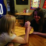 Arm wrestling with my waitress!