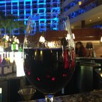 Having a glass of wine at the atrium bar