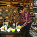 Kostas introducing us to olive oil and vinegar tasting (with a little wine to add)