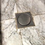 DANGEROUS 'flipping' drain cover in centre of bathroom floor