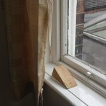 Ripped curtain and window block