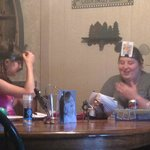 Silly Games at the dining room table, with couches seats 12+