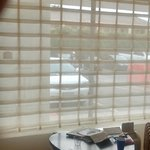 Window Treatments - There's a pull down shade for more privacy.