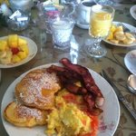 Our breakfast this morning: peach pancakes, bacon, omelet, fruit, coffee and Orange Juice