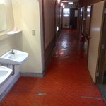 corridor to rooms and washing sinks: pic looks better than real