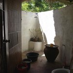 Bathroom with traditional mandi shower