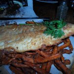 The best fish and chips. A knife is in the picture for scale of how big this fish is.