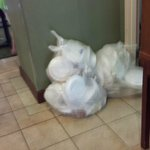Garbage piled in doorway during breakfast