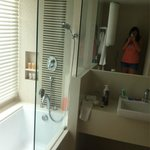 Business suite bathroom. Very large bath. Rain shower