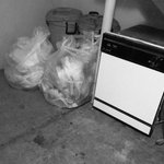 trash piled outside room 128