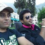 Vinod n Raj sitting in the lawn enjoying the lake view