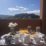 Breakfast and a view of the Acropolis from our balcony at O&B.