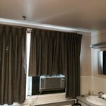 Noisy Wall Mounted AC Unit and drapery cut to fit
