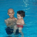With my child in the swimming pool