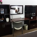The entertainment area with DVD player, coffee maker, TV