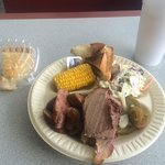 Brisket and sausage, corn on the cob and sweet slaw