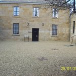 One of the main buildings, the foreground shows the kind of gravel referred to in the review...