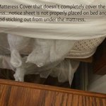Fitted sheet half on mattress and torn matress cover