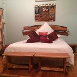bed with local artwork in Chalet 1