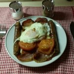Sausages, bacon, eggs & tomato breakfast
