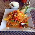 Check it out, spicy shrimp, pineapple, peppers, served in a pineapple halfshell with mango sauce
