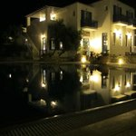 Hotel and pool by night.