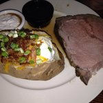 Prime rib with loaded baked potato.