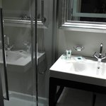 Shower recess & large basin.