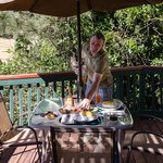 Jim, our awsome chef and host serving breakfast on the deck