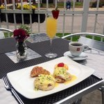 Eggs Benedict , coffee and a mimosa