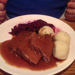 Sauerbraten with dumibgs and red cabbage