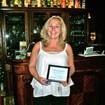 Inn owner, Karen Berry, receives Certificate of Appreciation from Local club.