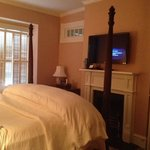 bedroom in barrymore suite with fireplace and tv