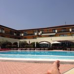 At the big pool in front of the Hotel together with a nice view above the Lake Garda!