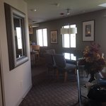 Entry into the suite, closet on the left,  dining room table with seating for six, balcony to th
