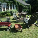 Prairie House front lawn fire pit- wagons for collecting firewood