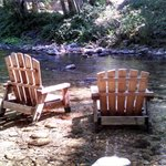 Adirondack chairs behind the Big Sur River Inn