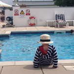 Son by the pool