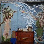 The mural around bathroom doors, which are Medusa and Zeus.
