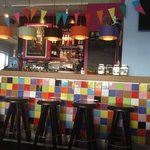 colourful, hip, friendly bar.